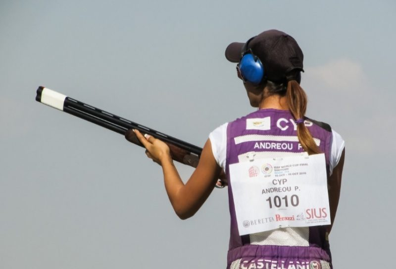 Woman skeet shooting